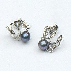 Handgemaakte zilveren oorstekers algo pequeño van flamencosieraden.nl