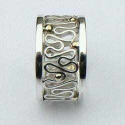 Handgemaakte zilveren ring met goud La flor van edelsmid Flamenco