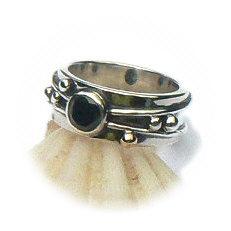 Handgemaakte zilveren ring met goud en zwarte zirkonia Flower Power van flamencosieraden.nl