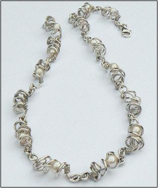 Handgemaakt zilveren collier La belleza van goudsmidsatelier Flamenco