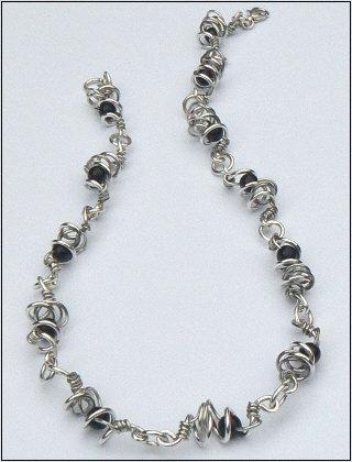 Handgemaakt zilveren collier La noche van flamencosieraden.nl