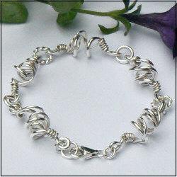 Handgemaakte zilveren armband El baile van flamencosieraden.nl