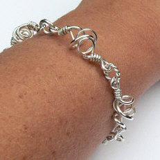 Handgemaakte zilveren armband El baile