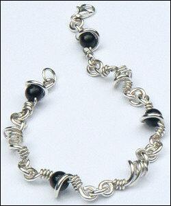 Handgemaakte zilveren armband Jungla van flamencosieraden.nl