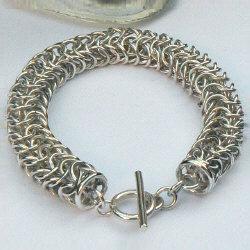 Handgemaakte zilveren armband La pulsera van flamencosieraden.nl