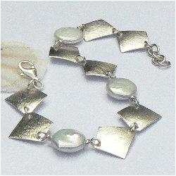 Handgemaakte zilveren design armband Agua Dulce van flamencosieraden.nl
