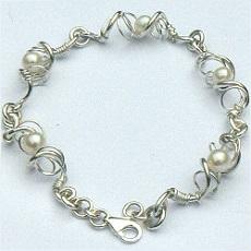 Handgemaakte zilveren armband La belleza van goudsmidsatelier Flamenco