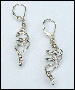 Handgemaakte zilveren oorhangers El baile van flamencosieraden.nl