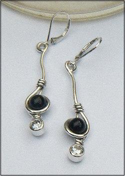 Handgemaakte zilveren oorhangers Algo más