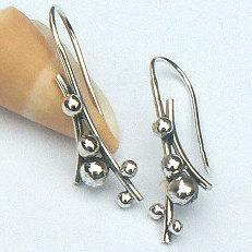 Handgemaakte zilveren oorhangers by Flamenco
