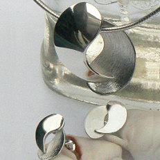 Handgemaakte zilveren set Juntos van goudsmidsatelier Flamenco