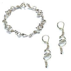 Handgemaakte zilveren armband met oorhangers van flamencosieraden.nl