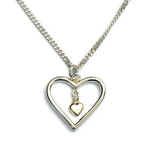 Handgemaakte zilveren hanger hart met een klein gouden hartje