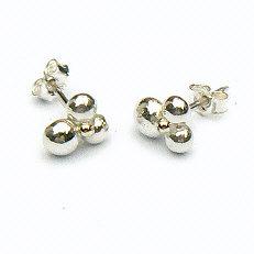Handgemaakte zilveren design oorstekers met goud Sonrisa