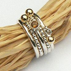 Handgemaakte zilveren Amigas ringen met gouden ballen