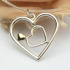 Handgemaakt zilveren hart met hartje en gouden hartje by Flamenco