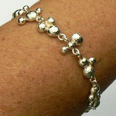 Handgemaakte zilveren armband Agua del cielo van flamencosieraden.nl