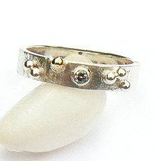 Handgemaakte zilveren ring met goud Sueño van flamencosieraden.nl
