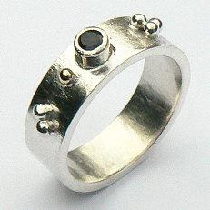 Handgemaakte zilveren ring met goud 7 mm Sueño van edelsmid Flamenco