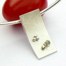 Handgemaakte zilveren hanger met goud Sueño van flamencosieraden.nl