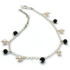 Zilveren enkelbandje onyx parels