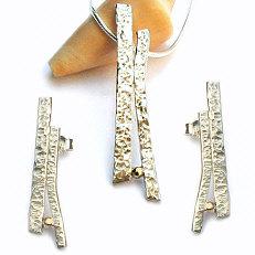Handgemaakte zilveren set met goud Selva tropical