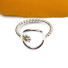 Zilveren combi-ring met rose-gouden bol